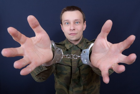 Portrait of the man with handcuffs on hands photo