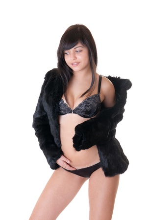 The sexy girl in black underwear and a fur coat photo