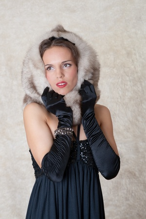 Portrait of the girl with furs against a fell Stock Photo - 9086742