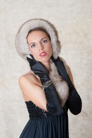 Portrait of the girl with furs against a fell photo