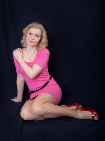 The nice blonde in a pink dress photo