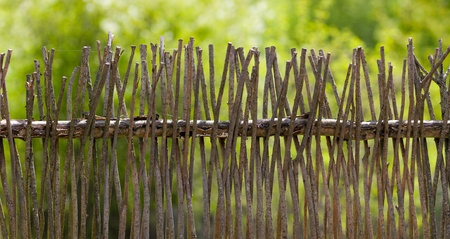 Wooden fence in village from willow branches Stock Photo - 9598691