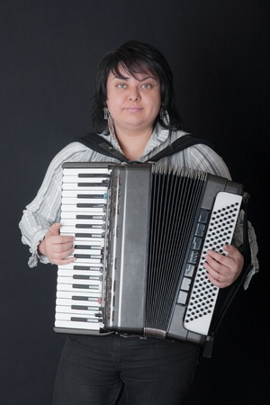 Portrait of the girl with an accordion photo