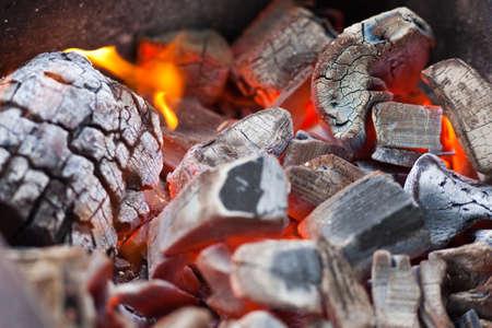wood burning: Burning coals for a shish kebab close up Stock Photo