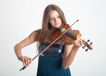 Portrait of the girl playing a violin Stock Photo - 9923155