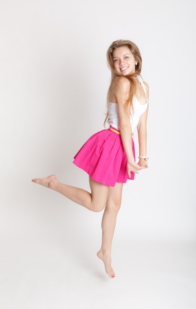 long skirt: Portrait of the blonde in a pink skirt Stock Photo