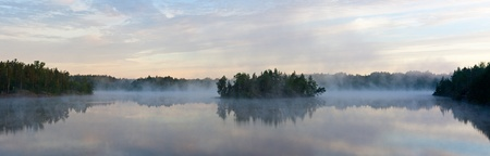 Morning fog over wood lake, a panorama photo