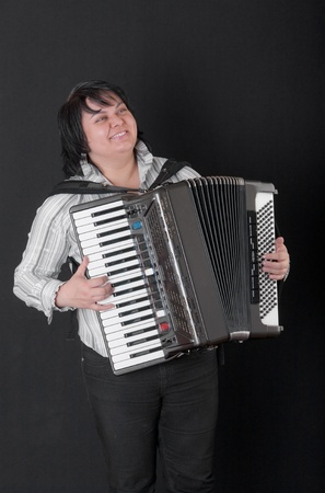 Portrait of the girl playing an accordion Stock Photo - 10334669