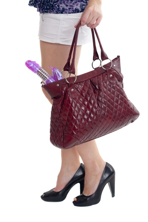 Ladies handbag in hands with the vibrator Stock Photo