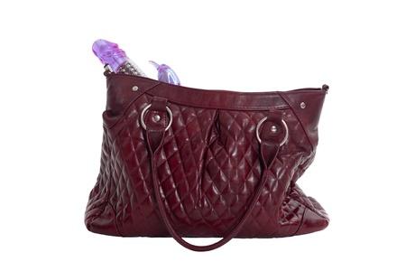 Female handbag with the vibrator, isolated on white Stock Photo - 11008009