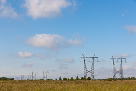 Landscape with an electric main in countryside photo