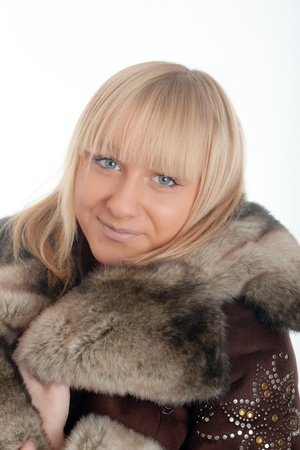Portrait of the blonde in a fur coat Stock Photo