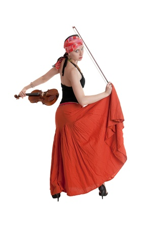 The girl in a red skirt with a violin photo