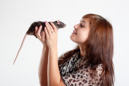 Portrait of the girl with a black rat photo
