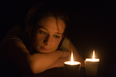 Portrait of the romantic girl by the light of candles Stock Photo - 12508703