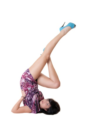 headstand: the girl does a headstand, isolated on white