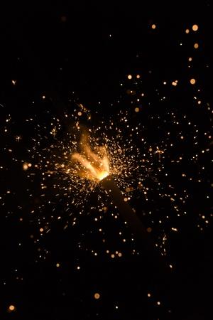 sparking: sparking Bengal fires on black background closeup