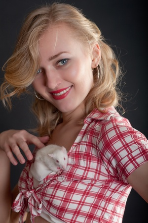 the girl with a white rat on a breast photo