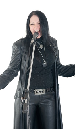 the rock singer in black before a microphone photo