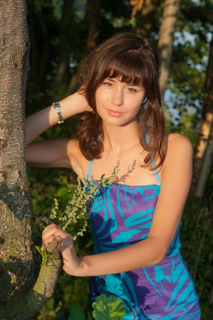portrait of the beautiful girl among trees Stock Photo - 13569079