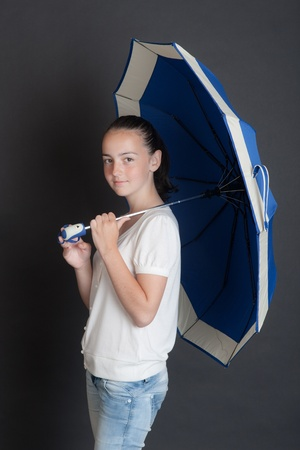 portrait of the girl with a dark blue umbrella photo