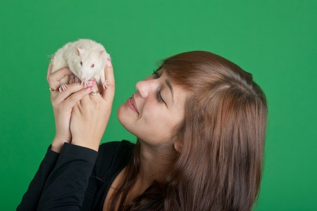 Portrait of the girl with a white rat photo