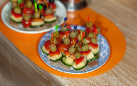 canape from vegetables and cheese on a table photo