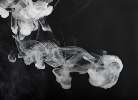 Cigarette smoke close up on a black background, abstract background photo