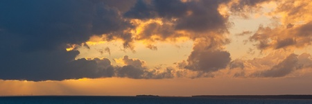 bright decline over the sea in cloudy evening Stock Photo - 15138793