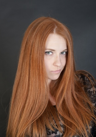 girl with red hair on a black background photo