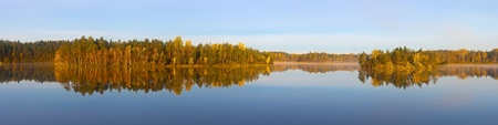 Panorama of wood lake in the autumn. Two islands photo