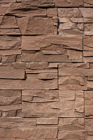 fragment of a stone wall from rough rectangles photo