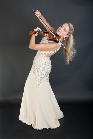 portrait of the violinist in an evening dress photo