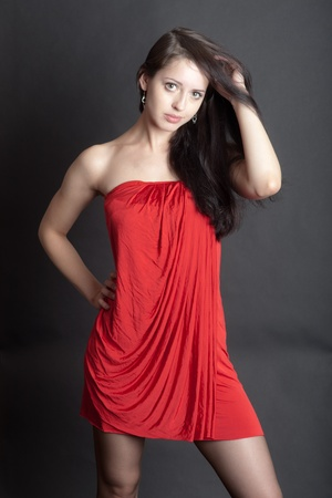 girl in a red dress on a black background photo