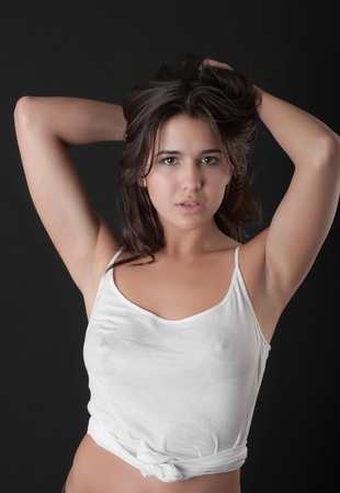 sensual girl in a wet white shirt photo