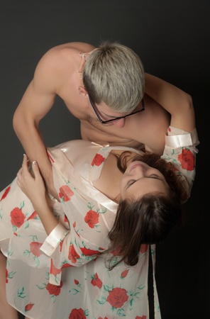 couple in passionate embrace on a black background photo