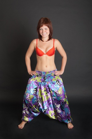 beautiful girl in a bright colored Indian trousers photo