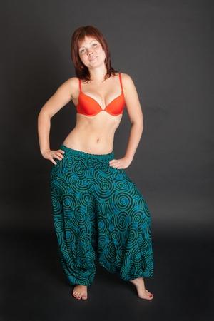 beautiful girl in a bright cyan Indian trousers photo