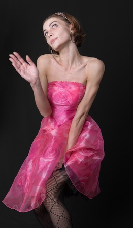 La muchacha delgada en un vestido rosa Foto de archivo - 18184267
