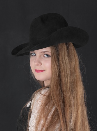 portrait of a girl in a black hat photo