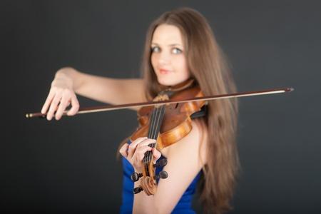 Portrait of violinist on black background closeup photo