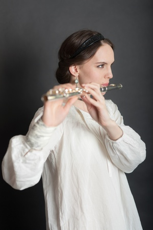 portrait of a girl with a flute (focus on the eyes) photo
