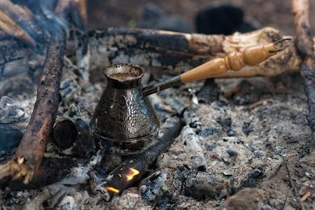 cezve: making coffee in cezve on coal fire
