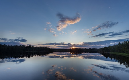 beautiful sunset over the forest lake with reflections photo