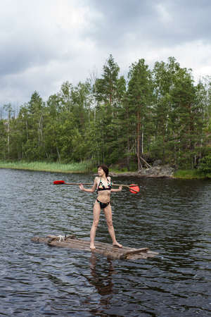 woman on a raft in the lake water Stock Photo - 20696645