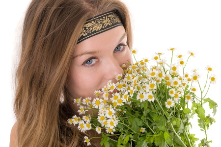 portrait of a girl with a bouquet of daisies photo