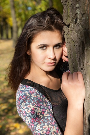 portrait of a beautiful girl in the autumn park photo