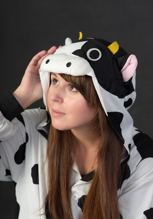 portrait of a girl in a cow costume photo