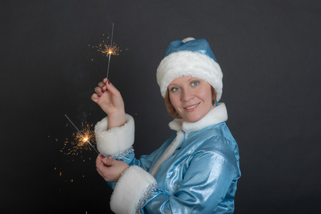 girl in suit Snow Maiden with sparklers Stock Photo - 23946703