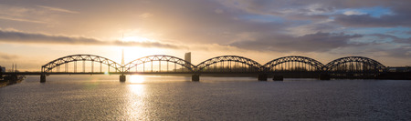 The railway bridge in Riga at sunrise photo